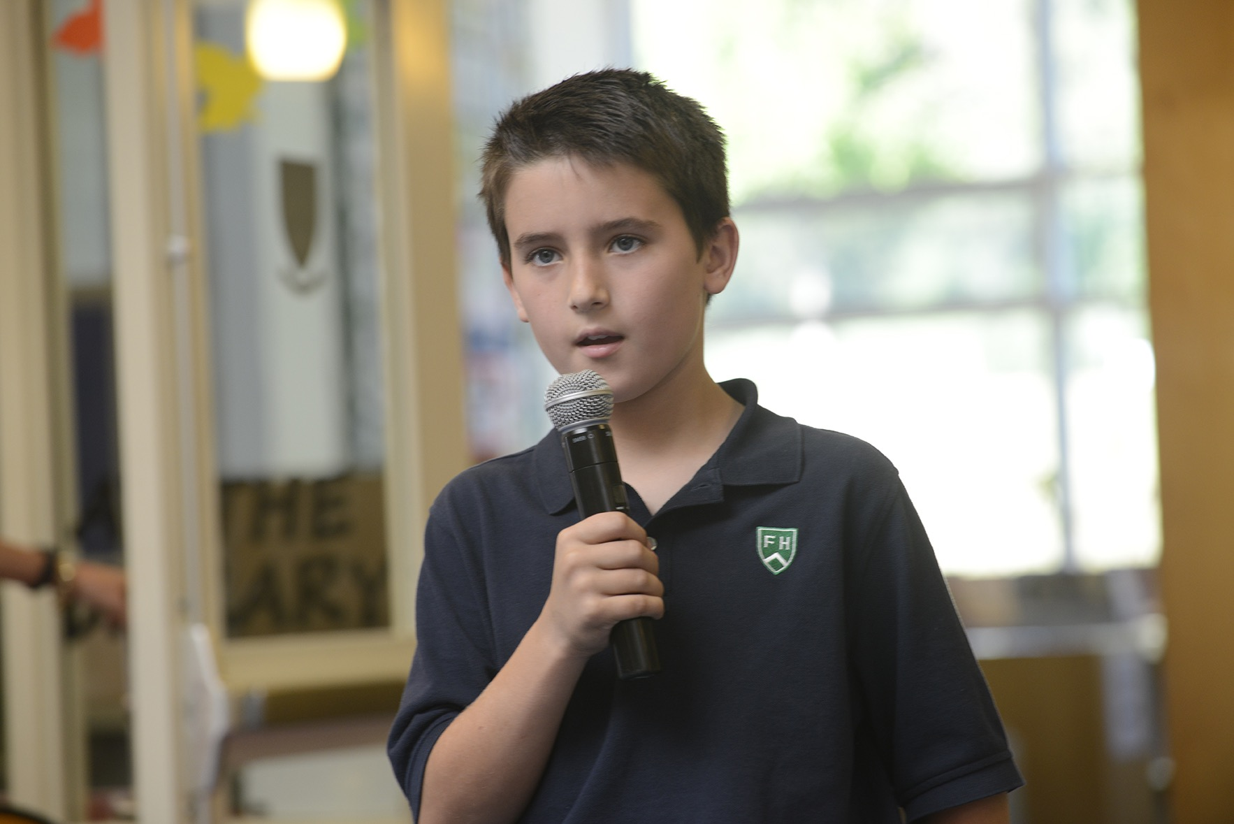 Boy holding microphone