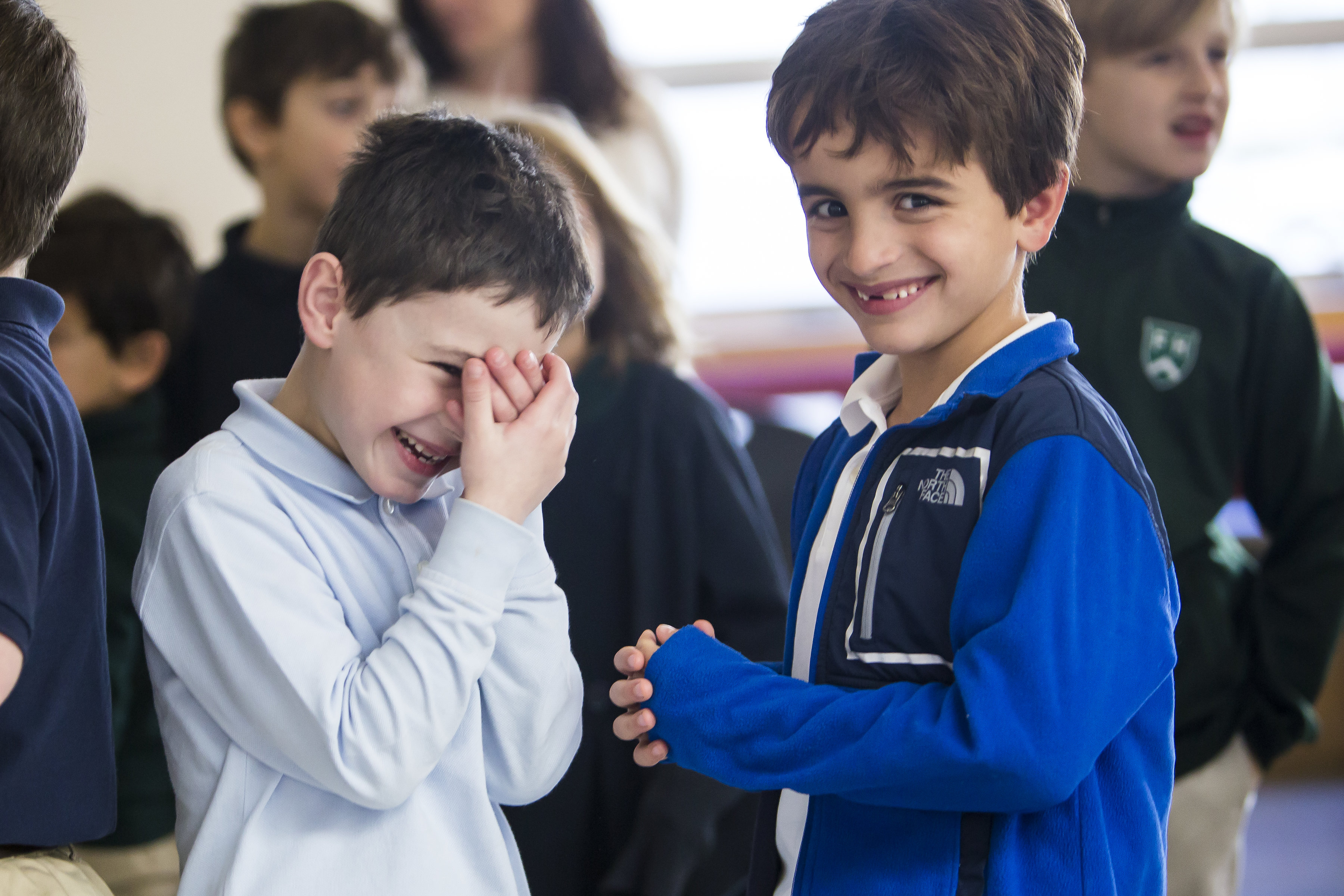 Boy students laughing