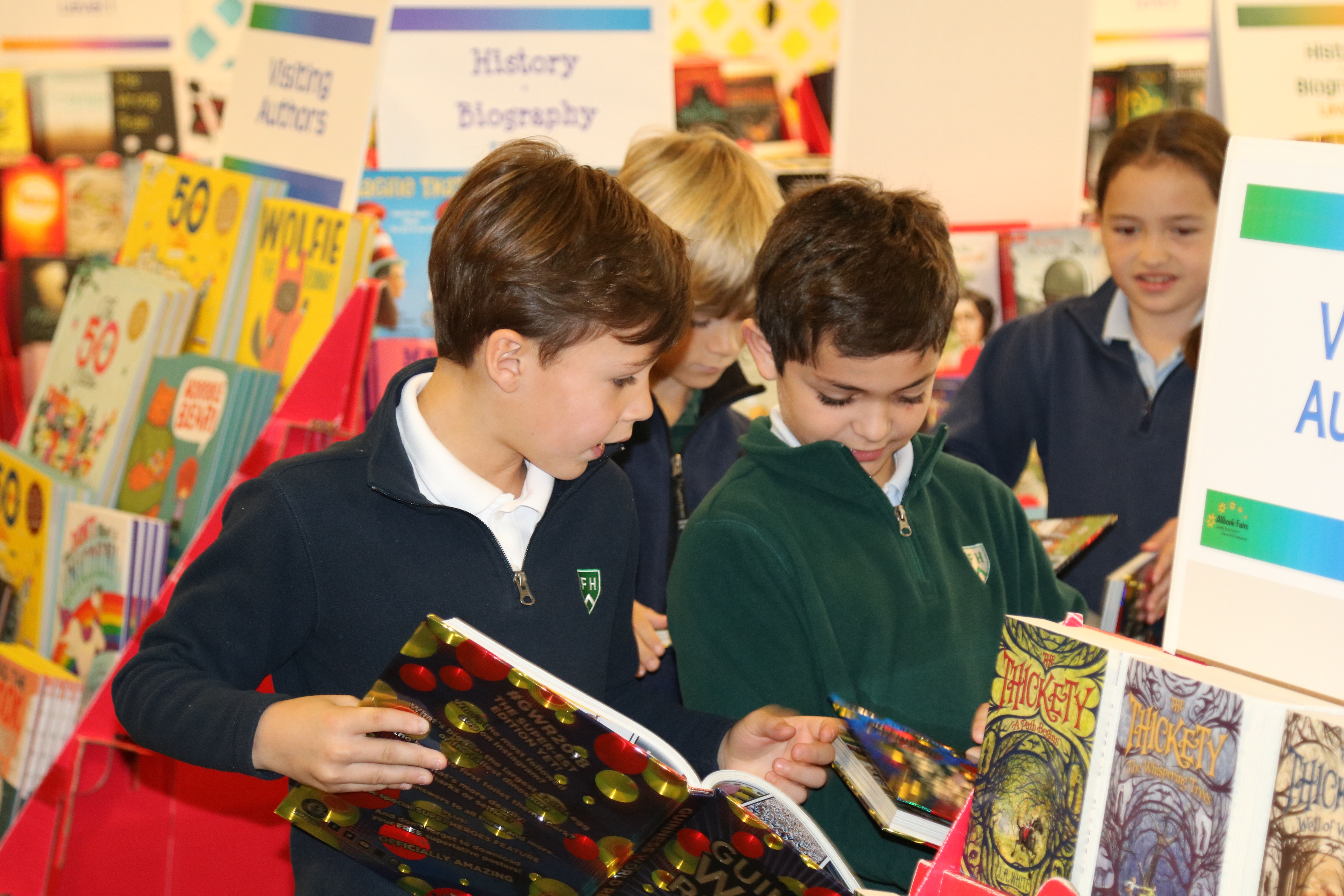 Boys reading at the School Book Fair