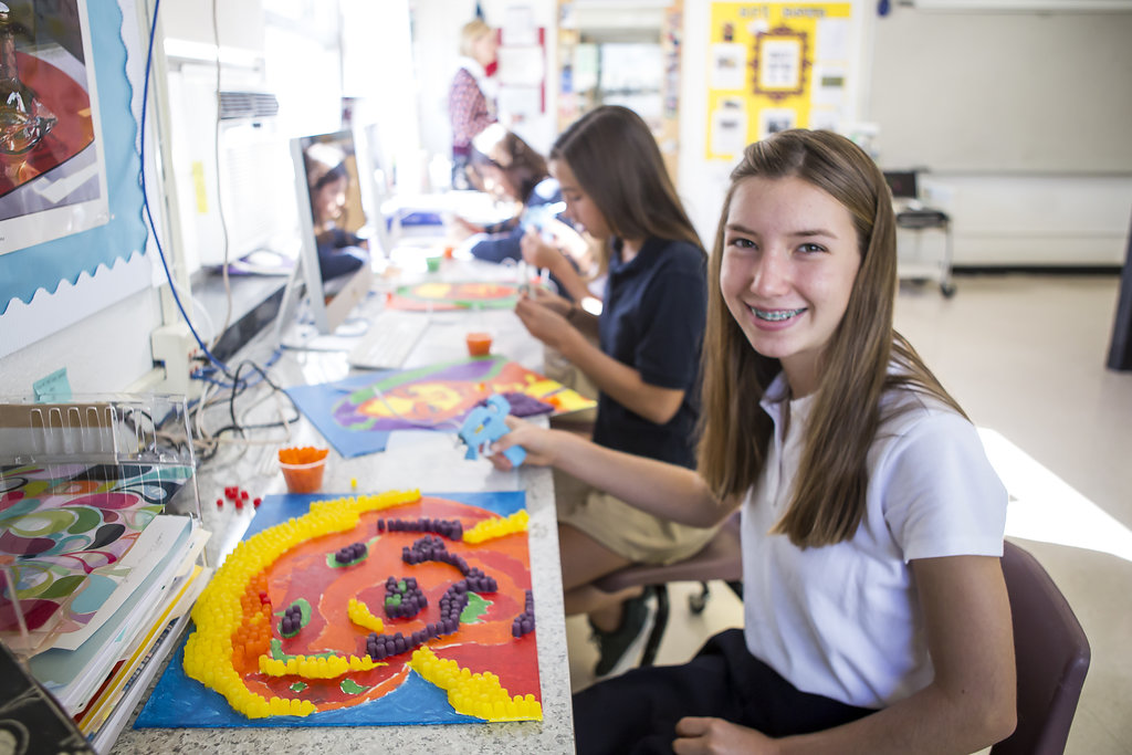 Upper school students making art