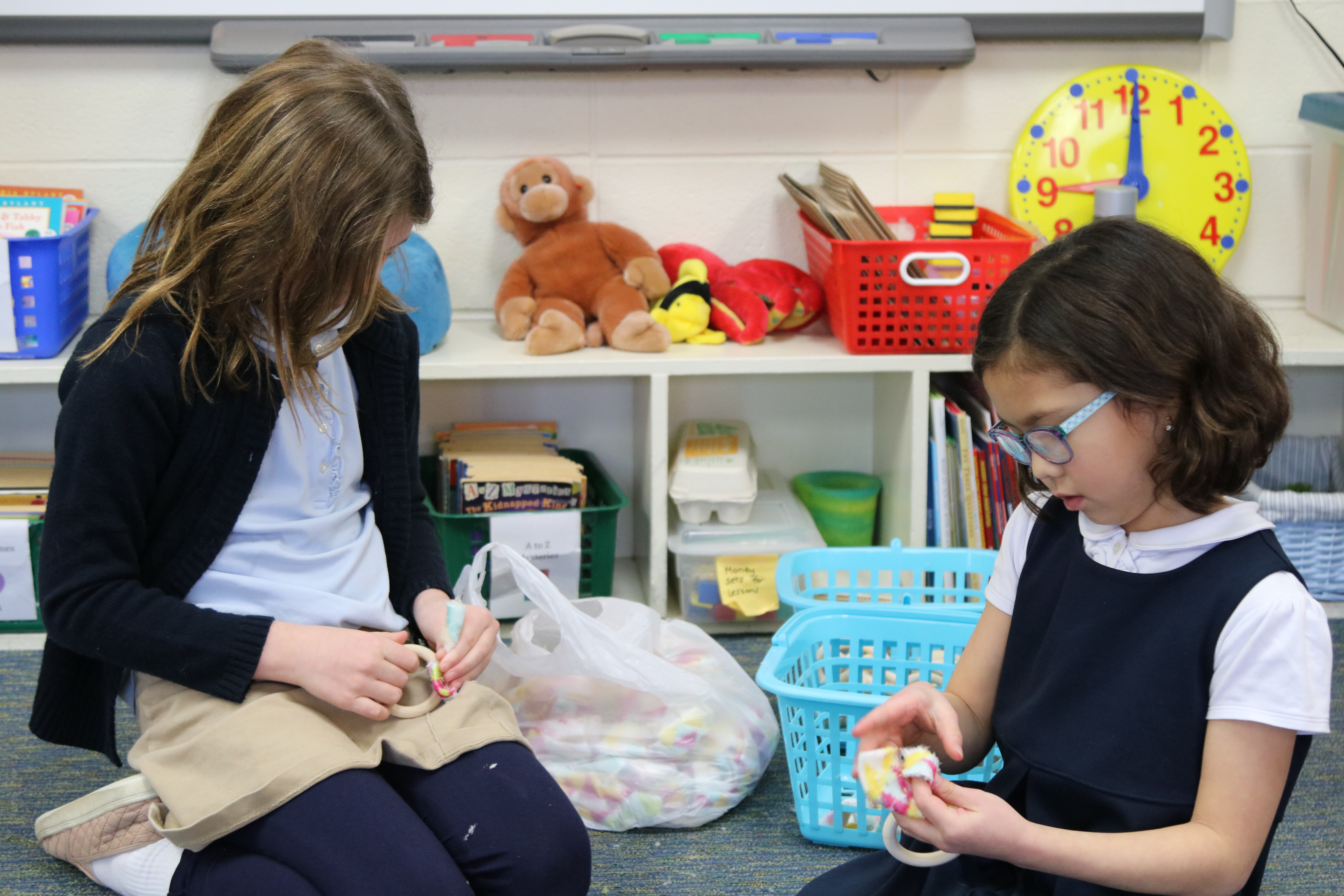 Grade 2 students work to make toys for cats during service learning project.