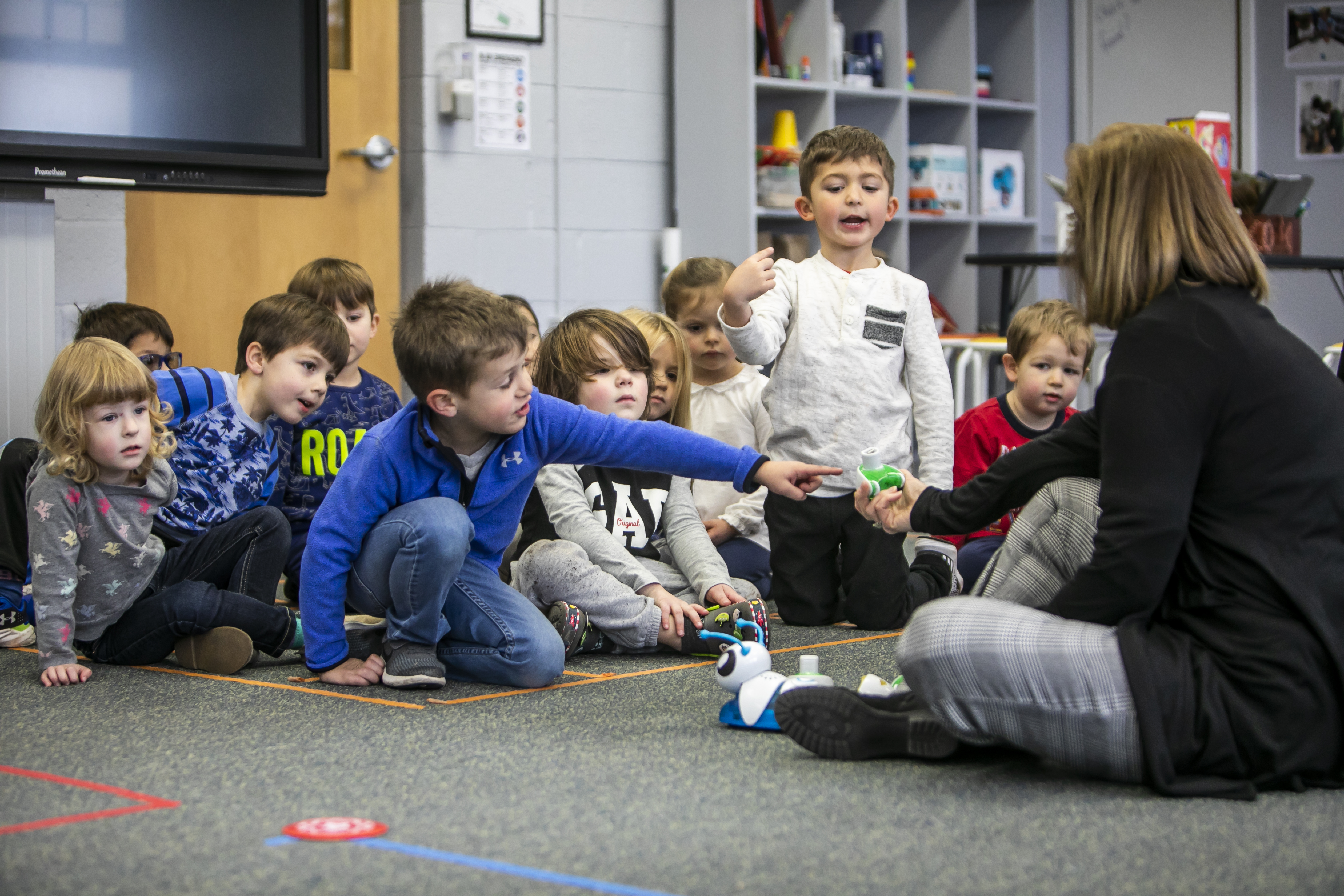 Kindergarten students learning robotics