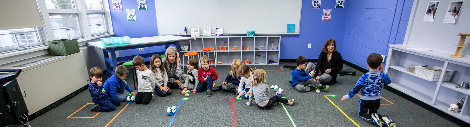 Pre-schoolers playing with robotics